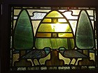A stain glass panel from a Three fold screen the design attributed to CFA Voysey and probably excecuted by Liberty and Co
