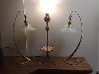 A W.A.S.Benson Lily table lamp flanked by a rare pair of Swan lamps